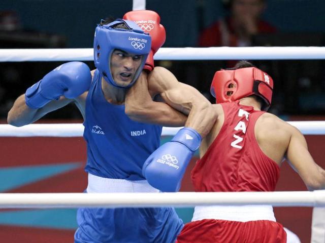 Kazakhstan-s-Gani-Zhailauov-R-fights-Jai-Bhagwan-during-their-men-s-light-60-kg-boxing-match-at-the-2012-Summer-Olympics-in-London-AP-Ivan-Sekretarev