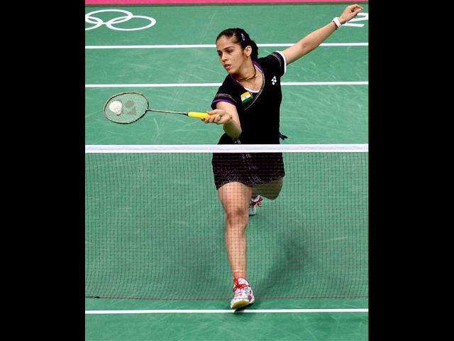 Saina-Nehwal-plays-a-shot-against-China-s-Wang-Yihan-during-the-semifinal-match-of-women-s-singles-badminton-at-the-Olympic-Games-in-London-PTI-Manvender-Vashist