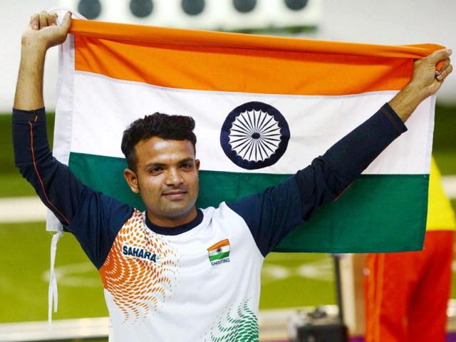 Vijay-Kumar-celebrates-with-a-Tricolour-after-winning-silver-medal-in-the-men-s-25m-rapid-fire-pistol-shooting-event-at-the-2012-Olympic-Games-in-London