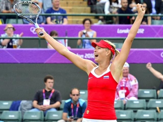 Russia-s-Maria-Sharapova-celebrates-her-victory-over-Russia-s-Maria-Kirilenko-in-their-women-s-single-tennis-semifinal-match-at-the-London-2012-Olympic-Games-in-London-AFP-Luis-Acosta