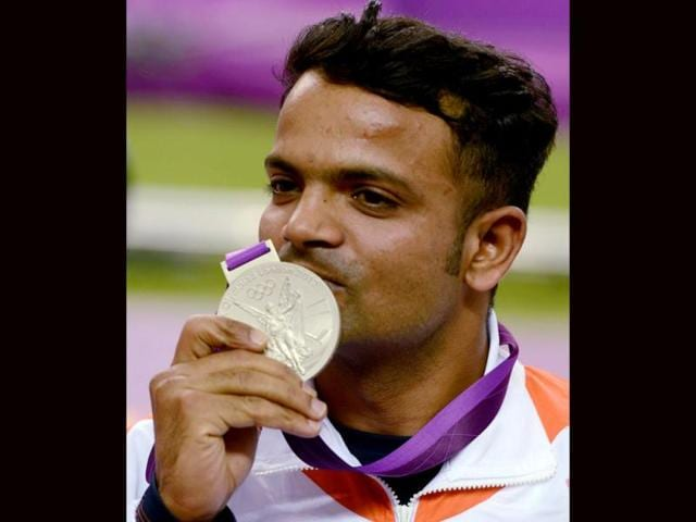India-s-Vijay-Kumar-celebrates-after-winning-silver-medal-in-the-men-s-25m-rapid-fire-pistol-shooting-event-at-the-2012-Olympic-Games-in-London-on-PTI-Photo-by-Manvender-Vashist