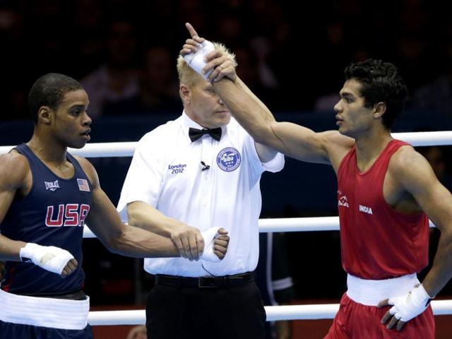 Vikas-Krishan-reacts-after-defeating-the-United-States-Errol-Spence-during-a-men-s-welterweight-69-kg-preliminary-boxing-match-at-the-2012-Summer-Olympics-in-London-AP-Ng-Han-Guan