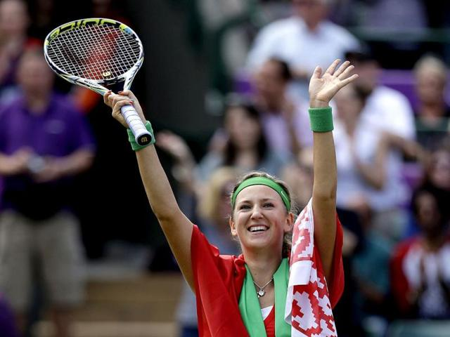 Victoria-Azarenka-of-Belarus-draped-in-her-country-s-flag-waves-after-beating-Maria-Kirilenko-of-Russia-to-win-the-women-s-singles-bronze-medal-match-at-the-All-England-Lawn-Tennis-Club-at-Wimbledon-in-London-at-the-2012-Summer-Olympics-AP-Photo