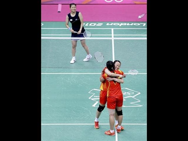 China-s-Tian-Qing-and-Zhao-Yunlei-facing-camera-embrace-each-other-after-winning-the-women-s-doubles-badminton-gold-medal-defeating-Japan-s-Reika-Kakiiwa-and-Mizuki-Fujii-unseen-at-the-2012-Olympics-in-London-AP-Photo-Saurabh-Das