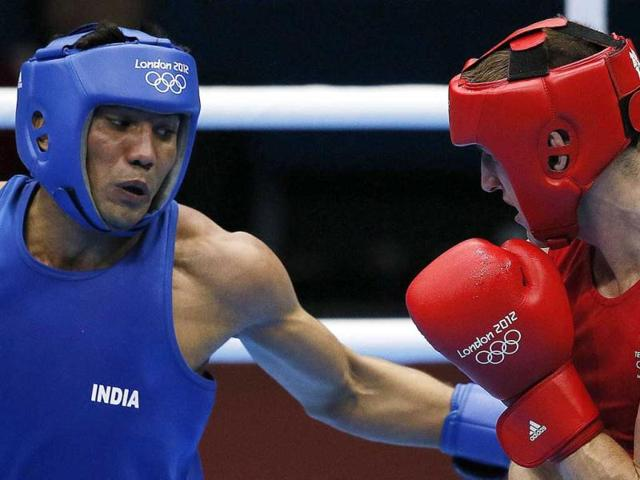 Manoj-Kumar-L-of-India-defends-against-Thomas-Stalker-R-of-Great-Britain-during-their-round-of-16-light-welterweight-64kg-match-of-the-London-2012-Olympic-Games-at-the-ExCel-Arena-in-London-AFP-Jack-Guez