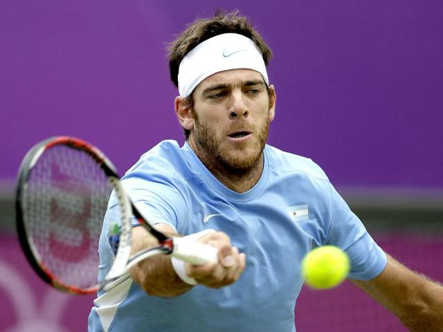Juan-Martin-del-Potro-of-Argentina-returns-a-shot-to-Novak-Djokovic-of-Serbia-in-the-men-s-singles-bronze-medal-match-at-the-All-England-Lawn-Tennis-Club-at-Wimbledon-in-London-at-the-2012-Summer-Olympics-AP-Photo-Mark-Humphrey