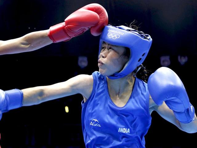 MC-Mary-Kom-is-declared-the-winner-over-Maroua-Rahali-of-Tunisia-after-their-quarterfinal-Women-s-Fly-51kg-boxing-match-at-the-London-Olympic-Games-Reuters-photo-Murad-Sezer