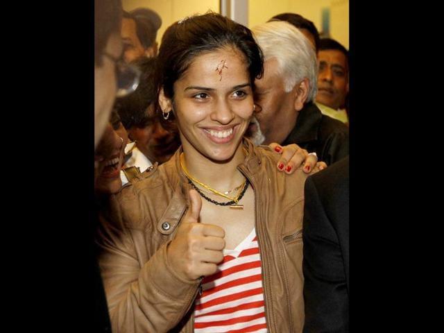 Saina-Nehwal-at-Indira-Gandhi-International-Airport-in-New-Delhi-as-she-returns-from-London-after-winning-Olympic-Games-bronze-medal-in-badminton-HT-Photo-Arijit-Sen