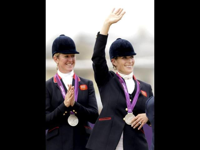 Members-of-the-British-equestrian-eventing-team-Zara-Phillips-right-and-Nicola-Wilson-receive-their-silver-medals-after-Great-Britain-took-second-place-in-the-equestrian-eventing-team-competition-at-the-2012-Summer-Olympics-in-London-AP-Photo