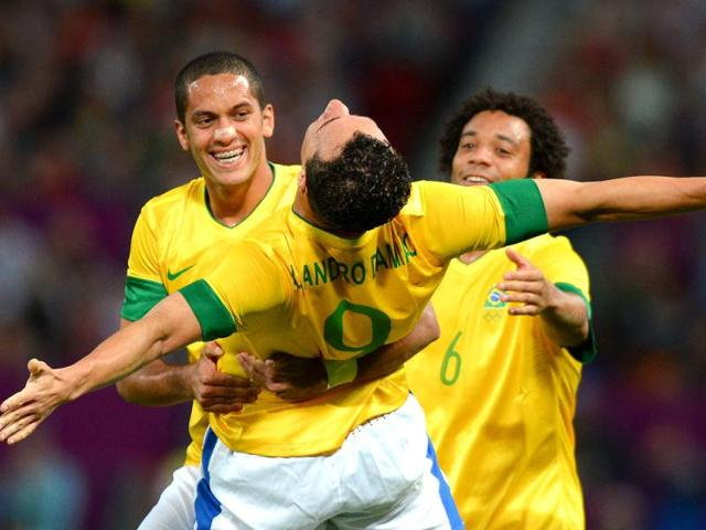 Brazil-s-forward-Leandro-Damiao-C-celebrates-with-Brazil-s-defender-Romulo-L-and-Brazil-s-defender-Marcelo-after-scoring-the-third-goal-during-the-London-2012-Olympic-Games-mens-semi-final-football-match-between-Brazil-and-South-Korea-at-Old-Trafford-in-Manchester-north-west-England-AFP-Andrew-Yates