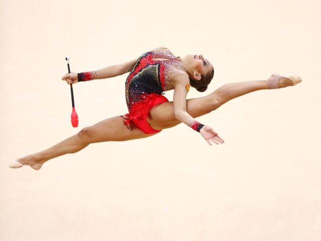 Russia-s-Evgeniya-Kanaeva-competes-using-the-clubs-in-their-individual-all-around-gymnastics-final-match-at-the-Wembley-Arena-during-the-London-2012-Olympic-Games-Reuters-photo-Mike-Blake