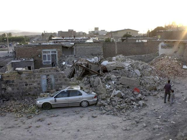 Residents-of-the-city-of-Varzaqan-sit-at-the-side-of-a-street-after-an-earthquake-in-northwestern-Iran-AP-Kazem-Yousefi