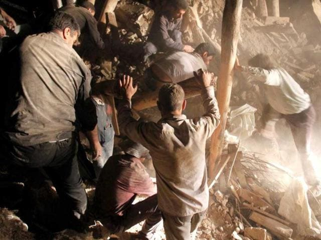 Iranian-residents-and-rescue-workers-search-for-survivors-in-the-rubble-of-a-house-in-a-village-near-the-town-of-Varzaqan-Iran-AFP-Photo