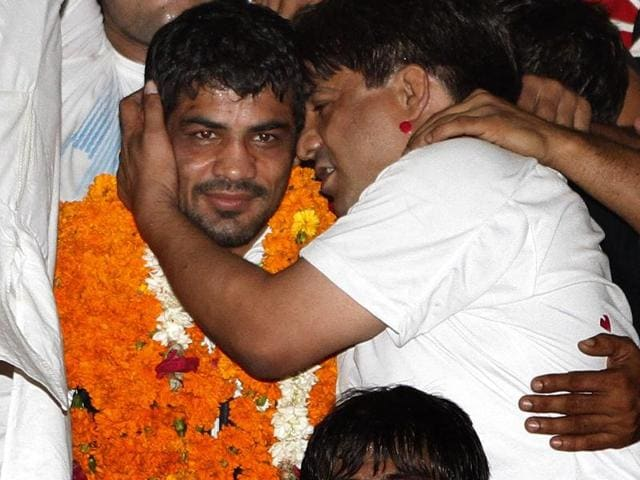 Wrestler Sushil Kumar, who won Silver medal at London Olympics, is being greeted by his fans upon arrival at New Delhi's international airport. (Arijt Sen/HT Photos)