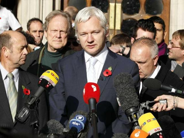 File-The-founder-of-WikiLeaks-Julian-Assange-center-gives-a-statement-to-the-media-after-his-extradition-hearing-at-the-high-court-in-London-Ecuador-accused-Britain-of-threatening-to-storm-its-London-embassy-to-arrest-Assange-after-the-UK-issued-a-stern-warning-to-the-South-American-nation-ahead-of-its-decision-on-an-asylum-bid-by-the-WikiLeaks-founder-AP-Kirsty-Wigglesworth