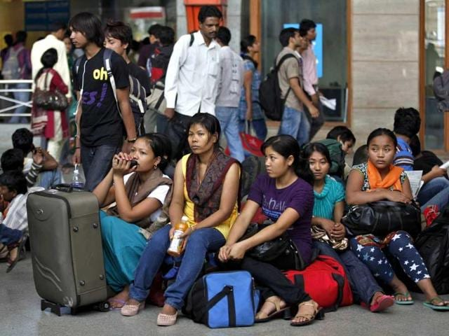 Northeastern-women-wait-with-their-baggage-to-board-trains-home-at-a-railway-station-in-Bangalore-Thousands-of-people-from-the-northeast-are-fleeing-the-IT-city-spurred-by-rumours-they-would-be-attacked-in-retaliation-for-communal-violence-in-Assam-AP-Aijaz-Rahi