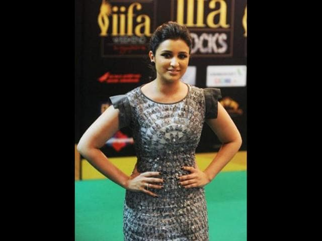 Parineeti-Chopra-kept-it-simple-with-a-powder-white-gown-as-she-posed-at-the-red-carpet-of-the-People-s-Choice-awards