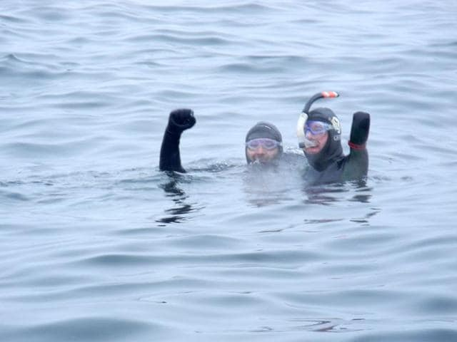 French-four-member-amputee-swimmer-Philippe-Croizon-R-and-his-friend-swimmer-Arnaud-Chassery-celebrate-after-he-swam-between-islands-in-the-icy-Bering-Strait-to-cross-from-America-to-Asia-in-the-final-part-of-a-quest-to-link-all-continents-AFP-photo
