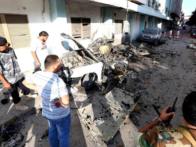 Libyan-security-forces-inspect-the-remains-of-a-vehicle-near-the-interior-ministry-of-Tripoli-after-twin-blasts-killed-two-people-in-the-Libyan-capital-AFP-Mahmud-Turkia