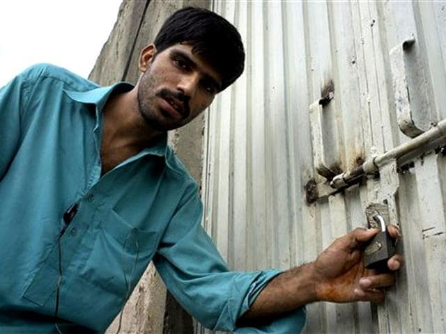 Mukhtar-Khan-neighbour-of-a-Christian-girl-arrested-for-alleged-blasphemy-shows-the-locked-house-of-a-girl-and-vowed-will-never-allow-them-to-live-in-this-neighborhood-in-a-suburb-of-Islamabad-AP-Photo-BK-Bangash
