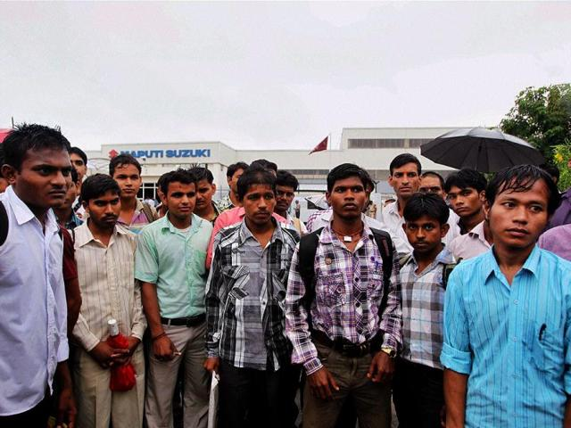 Newly recruited employees at Maruti Suzuki's Masesar plant which was reopened amid tight security after a month long lockout following violence. PTI Photo