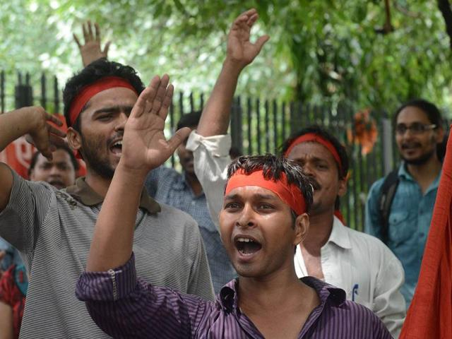 Sacked workers from Maruti Suzuki, trade unionists and family members of workers shout slogans and demand that sacked workers be reinstated during a protest in New Delhi. AFP Photo
