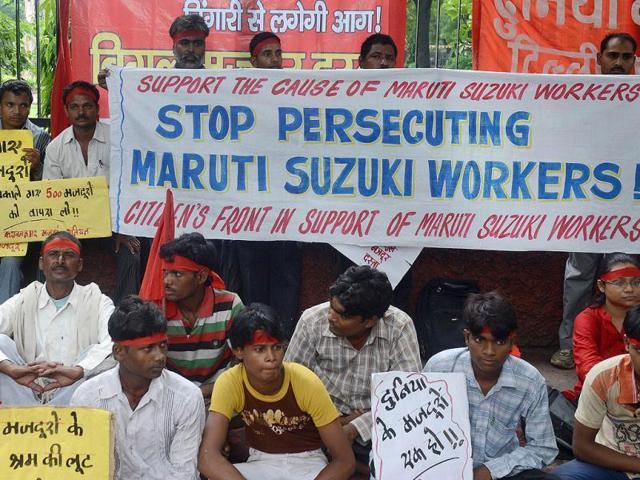 Sacked workers from Maruti Suzuki, trade unionists and family members of workers shouted slogans and demanded that sacked workers be reinstated during a protest in New Delhi. AFP Photo