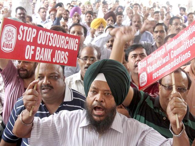 A-bank-employee-holds-a-placard-as-she-participates-in-a-protest-during-a-two-day-strike-in-Mumbai-AP-File-Photo
