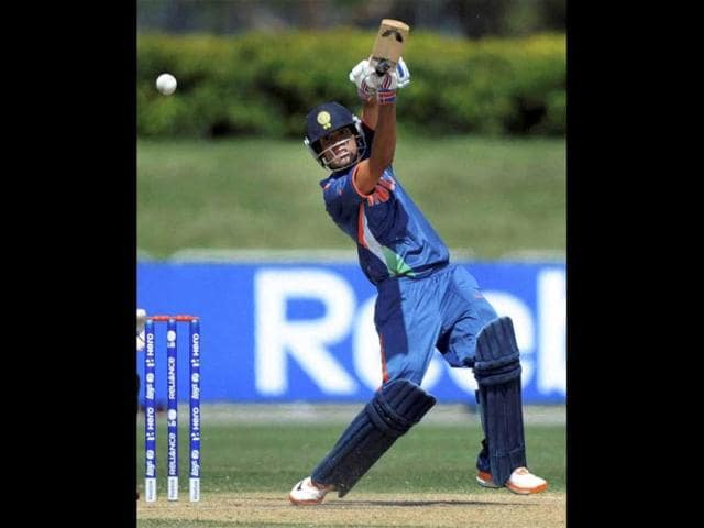 Prashant-Chopra-of-India-drives-down-the-ground-during-their-ICC-U19-Cricket-World-Cup-2012-semi-final-match-against-New-Zealand-at-Tony-Ireland-Stadium-in-Townsville-Australia-PTI-photo