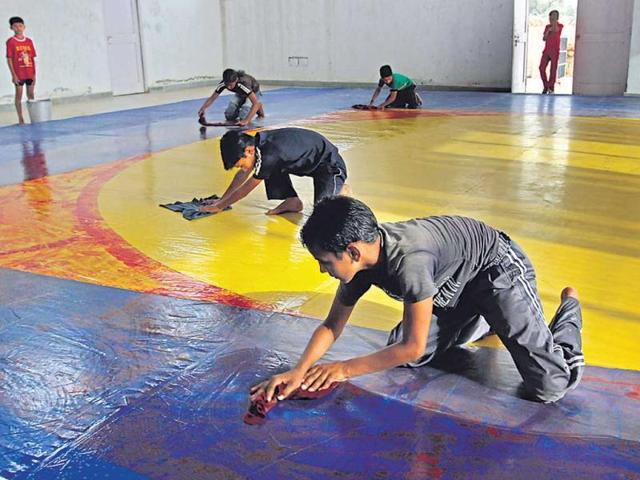 Trainees-at-the-stadium-are-made-to-sweep-and-mop-the-floors-of-the-indoor-facilities-Arijit-Sen-HT-Photo