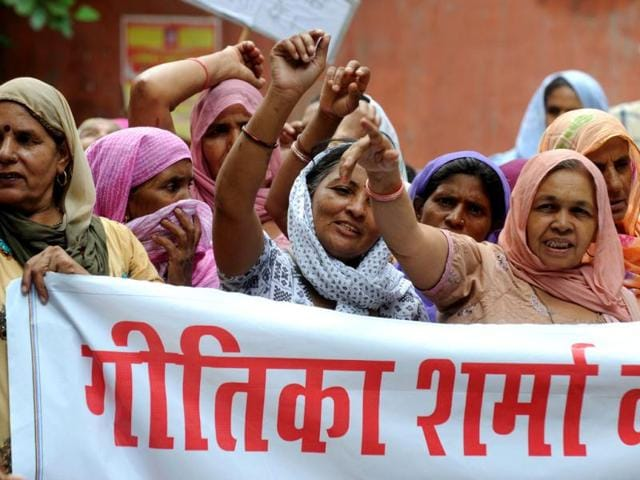 Village-women-shout-slogans-against-former-Haryana-state-minister-Gopal-Kanda-implicated-in-the-suicide-of-23-year-old-flight-attendant-Geetika-Sharma-AFP