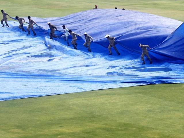 Groundsmen-remove-a-raincover-from-the-field-after-a-rain-delay-during-the-third-day-of-the-first-test-cricket-match-between-India-and-New-Zealand-in-Hyderabad-Reuters-Vivek-Prakash