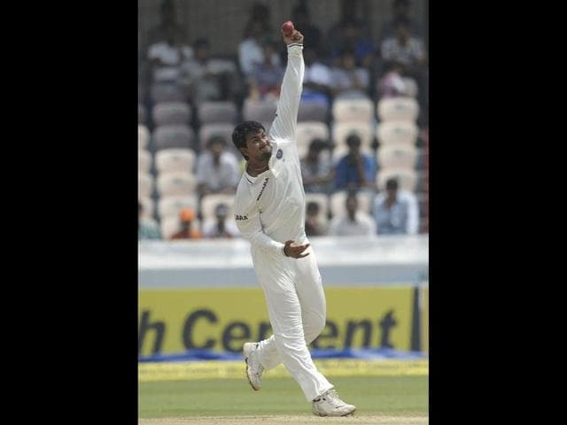 Indian-cricketer-Pragyan-Ojha-bowls-during-the-third-day-of-the-first-Test-match-between-India-and-New-Zealand-at-the-Rajiv-Gandhi-International-Cricket-Stadium-in-Hyderabad-AFP-Photo-Noah-Seelam