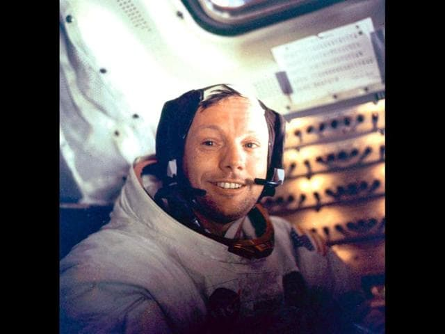 Apollo-11-space-mission-US-astronaut-Neil-Armstrong-is-seen-smiling-at-the-camera-aboard-the-lunar-module-Eagle-on-July-21-1969-after-spending-more-than-2-hours-on-the-lunar-surface-US-astronauts-Buzz-Aldrin-and-Neil-Armstrong-were-the-first-men-in-history-to-set-foot-on-the-moon-s-surface-After-about-seven-hours-of-rest-aboard-Eagle-they-were-awakened-by-Houston-to-prepare-for-the-return-flight-and-rejoin-Michael-Collins-aboard-Columbia-in-lunar-orbit-AP-photo