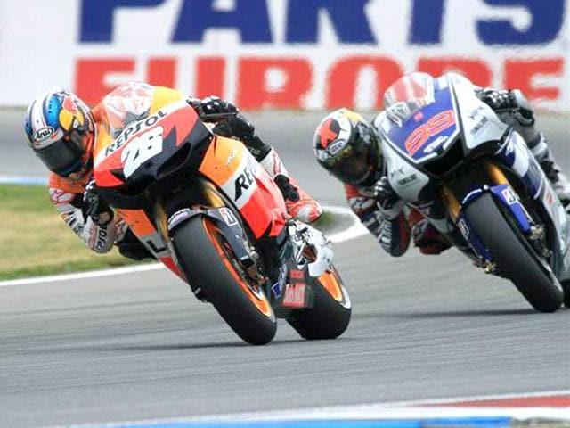Honda-s-Dani-Pedrosa-left-lies-just-13-points-behind-championship-leader-Jorge-Lorenzo-right-following-his-win-at-Brno-AFP-Photo