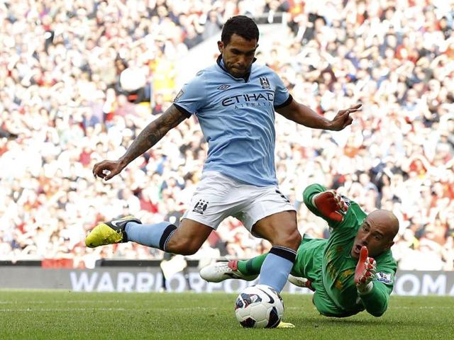 Manchester-City-s-Carlos-Tevez-shoots-past-Liverpool-s-Pepe-Reina-to-score-during-their-English-Premier-League-soccer-match-at-Anfield-in-Liverpool-northern-England-Reuters-Phil-Noble