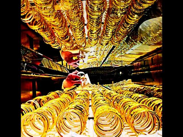 Gold slips from nearly 4-month high, down Rs 475