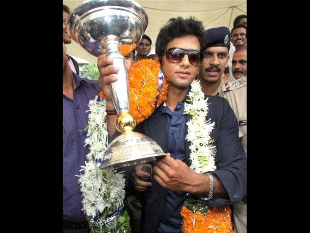 Under-19-Team-India-captain-Unmukt-Chand-being-welcomed-on-his-arrival-at-the-airport-in-Mumbai-PTI-Photo-Mitesh-Bhuvad