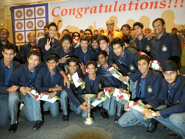 Under-19-Team-India-winners-of-the-ICC-Under-19-World-Cup-2012-tournament-pose-with-the-trophy-during-a-felicitation-ceremony-by-BCCI-in-Mumbai-AFP-Photo-Punit-Paranjpe
