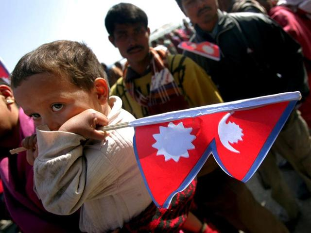 A-file-photo-showing-a-Nepali-child-holds-a-flag-during-a-rally-in-Kathmandu-Reuters-Photo