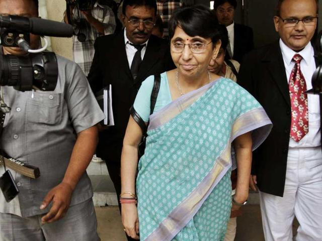 File-Former-Gujarat-minister-and-BJP-member-Maya-Kodnani-center-exits-a-court-in-Ahmedabad-A-special-court-found-32-people-including-Kodnani-guilty-for-their-role-in-the-Naroda-Patiya-riots-of-2002-The-court-acquitted-29-others-AP-Ajit-Solanki