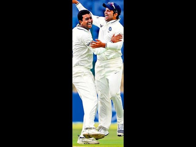 Pragyan-Ojha-left-celebrates-Martin-Guptill-s-dismissal-with-Suresh-Raina-in-Bangalore-on-Friday-AFP-Photo