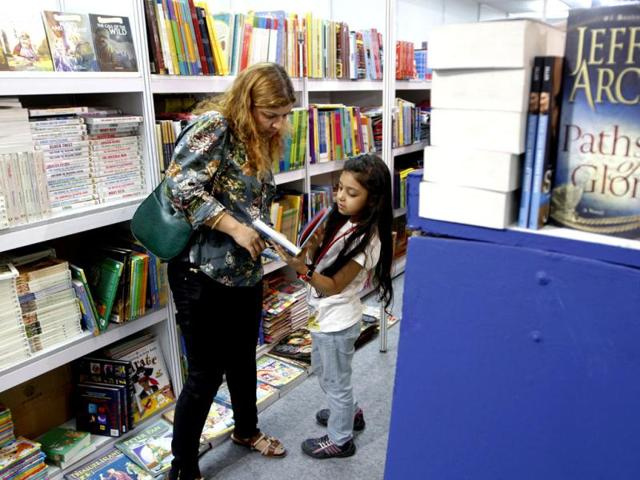 Visitors-look--through-books-during-the-ongoing-Delhi-Book-Fair-at-Pragati-Maidan-in-New-Delhi-HT-Photo-Sanjeev-Verma
