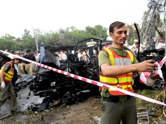 Pakistani-security-personnel-cordon-off-the-area-around-a-bomb-blast-site-in-Peshawar-AFP-Photo-A-Majeed