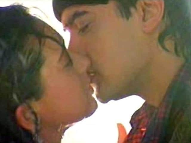One-of-the-first-of-it-s-kind-Aamir-Khan-and-Karisma-Kapoor-s-famous-smooch-in-Raja-Hindustani-not-only-made-waves-but-also-made-people-squirm-in-their-seats