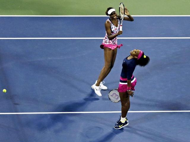 Venus-Williams-left-and-Serena-Williams-react-as-they-miss-a-point-during-a-match-against-Russia-s-Maria-Kirilenko-and-Nadia-Petrova-in-the-third-round-of-women-s-doubles-play-at-the-US-Open-tennis-tournament-in-New-York-Kirilenko-and-Petrova-won--6-1-6-4-AP-photo