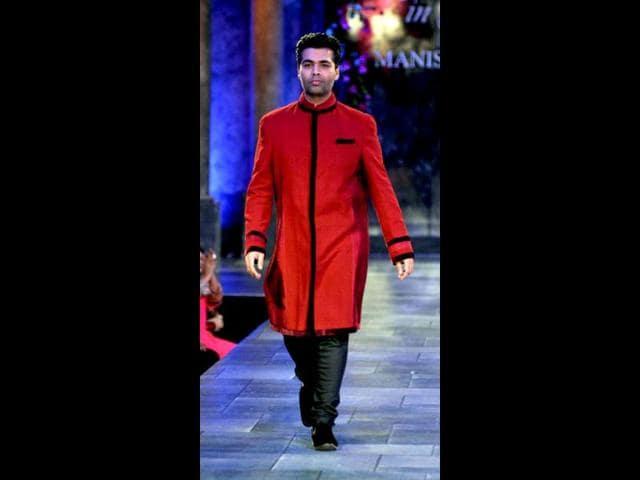 Karan-Johar-walks-for-The-Mijwan-Welfare-Society-fashion-show-Photo-AFP