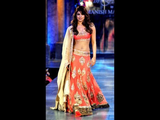 Priyanka-Chopra-looks-sizzling-hot-in-an-embellished-orange-lehenga-choli-Photo-AFP
