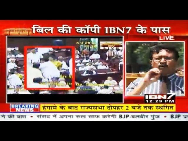 A-TV-grab-shows-Samajwadi-MP-Naresh-Agrawal-and-BSP-MP-Avtar-Singh-Karimpuri-engaged-in-a-scuffle-in-Parliament