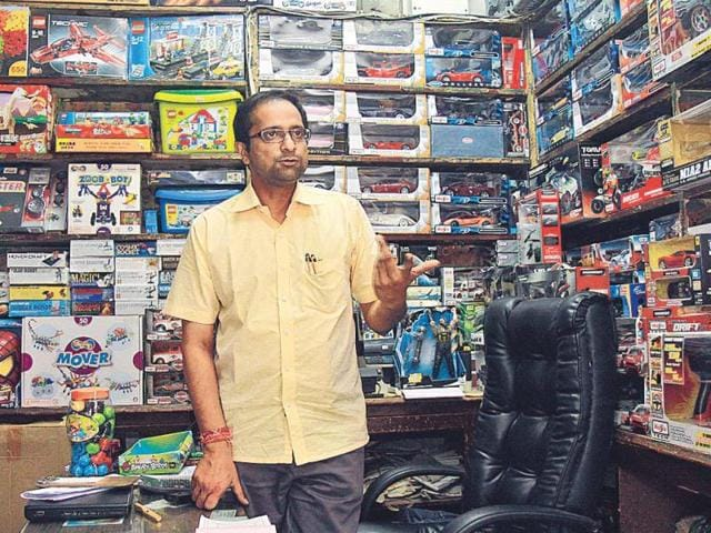 Shop-owner-Mahender-Pal-says-no-one-is-going-to-walk-a-long-way-in-the-dust-and-jump-ditches-in-CP-just-to-buy-foodstuff-from-his-shop-Vipin-Kumar-HT-photo